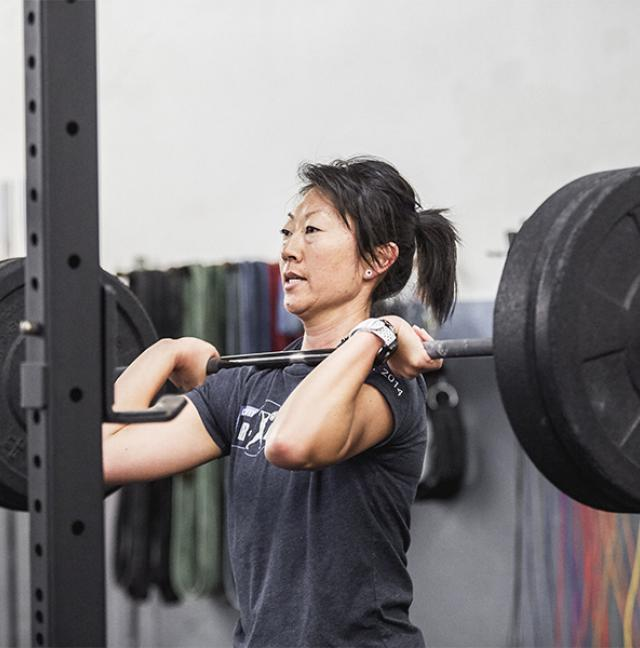 female lifting weight